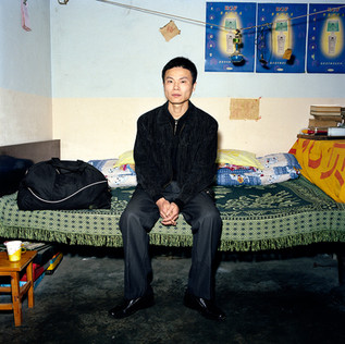 Peng Shu Lin is leaving tonight to work in Nigeria. He is 36. He has spent more than half of his life melting plastic in a state factory in Mianyang, his hometown in the center of China. His 90$ monthly salary is simply not enough anymore to live on and help his ageing parents. In Nigeria he will work in one of the 40 factories of a Honk Kong businessman, for a 550$ salary plus room and board. Peng Shu Lin has never left his Sichuan province, never taken a plane and never seen a black man, except on television. All he is taking to Africa is in the small sport bag next to him. He thinks that when he returns to China, in two or three years, he will have saved something like 15.000$, enough to get married and open an Internet café in his town.