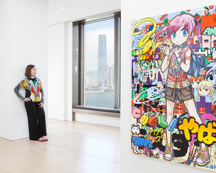 """Vicky Lam at the Hong Kong Perrotin Gallery, where she has just purchased, for $70,000, the manga-inspired painting hanging on her right entitled """"Such a Thrill...It's Crazy,"""" by the artist """"Mr."""" Ms. Lam is the director of Apex Property, a luxurious real estate development company active in Hong Kong, China, the UK, Australia and the USA. Investment in art has shot up in the last decade, proving to be safer then stocks, rivaling gold and attracting new kinds of investors who do not come from a collecting background. Many major art dealers, like Gagosian and Perrotin, eager to cater to this new market, have recently opened galleries in Hong Kong. Hong Kong"""