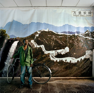In front of the offices of the Chambishi mine in Zambia, owned by the copper giant China Nonferrous Metal Mining company, the direction has hung a photomontage depicting the great wall, as a symbol of China, and the Victoria falls, as a symbol of Zambia.