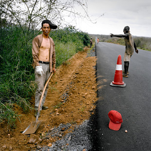 A Chinese labourer and an Angolan colleague working on the costal highway. China International Fund (CIF), the Chinese holding based in Hong Kong that oversees many contracts in Angola, has rebuilt this road, which unites the capital Luanda with Lobito, in record time.