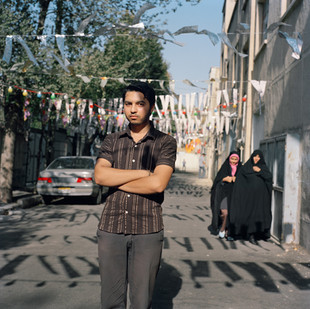 Omidreza, 20, lives in south Tehran and has been a member of the Basij for five years. Founded in 1979 by a decree of Ayatollah Khomeini, the Basij is Iran's volunteer army and played a fundamental role in its eight-year war with Iraq.  The organization claims to have 1 million registered members and sits somewhere between a reserve force and the Boy Scouts. Male and female members are offered spiritual and military training, computer classes, access to sports facilities and camping trips.  There are also reserved places for Basij at university. The Basij's block vote was vital for President Ahmadinejad's victory, and the organization is now enjoying a renaissance.  Omidreza attends meetings every Friday and his division is responsible for enforcing the Islamic dress code for women in his neighborhood, and for policing the activities of unmarried couples.  His father works in construction but Omidreza wants to join the Revolutionary Guards after his military service, which starts next year. He is optimistic for Iran's future. 'The country is getting better and better.  The only problem is that women do not cover themselves properly.' Iran, Tehran, August 2006.