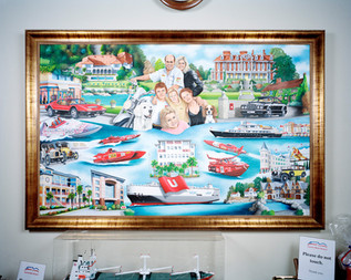 """Andreas Ugland and family are depicted in a large oil painting hanging at the entrance of Mr. Ugland's """"Cayman Motor Museum"""". The museum houses his unique collection of Ferraris, Rolls-Royces, Bentleys and vintage motorbikes. Mr. Ugland, who was born in Norway, acquired Caymanian citizenship in the 1990s. He is a billionaire, Chairman of Ugland International Holdings and runs a number of companies and banks in the Cayman Islands, the US and Europe. This painting illustrates his achievements and passions. At the center of the painting is the rather banal looking """"Ugland House,"""" a building where more then 19,000 companies are registered. It has become such a symbol of tax avoidance that President Obama has stated that """"either this is the largest building in the world or the biggest tax scam on record."""" Grand Cayman"""