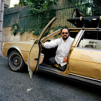 Seyed Abdullahi, 44, lost his bother and his two legs to a rocket attack while at the front in the Iran-Iraq war, for which he had volunteered as a Basij. He is photographed here in his modified Cadillac. Iran, Tehran, August 2006.