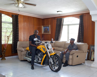 Mario Andrésol, a former military man under Jean-Claude Duvalier, former chief of the Haitian National Police, recently launched his own line of clothing. He parks his Harley-Davidson motorcycle in his living room. Belleville, Pétion-Ville. Haiti