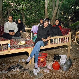 An Iranian family at a park in the outskirts of Shiraz where they have come to picnic and spend the day. This park, called Behesht Gomshode (lost paradise) is a place where dozens of family from Shiraz go to picnic and relax on the weekend. Iran, Shiraz, June 2009.