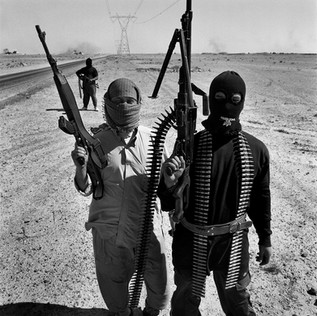 A group of insurgents in the desert near al-Garmagh. On this day the American army has started the offensive on the Sunni Insurgency that controles Fallujha and that has killed 4 mercenaries working for the Blackwater group. We were informed that the two men in the photograph were killed later the same day in the fighting around Falluja.
