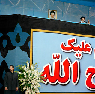 The Ayatollah Ali Khamenei, 70, the Supreme Leader of Iran, speaks at the mausoleum of his predecessor the Ayatollah Khomeini on the anniversary of his death. Iran, Tehran, June 2005.