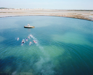 In a pool in St. Helier, children swim towards an artificial island. The pool is fed by the high tide's seawater. Jersey experiences tides of up to ten meters, some of the world's largest. Jersey is ranked ninth on the 2013 financial secrecy index compiled by the Tax Justice Network, making it one of the world's most important secrecy jurisdictions. Jersey