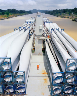 The Gong Yi 1, a Panamax ship carrying giant propellers built in China for a wind farm in the US, passes through the Culebra Cut while transiting the Panama Canal from the Pacific Ocean to the Atlantic. Panama