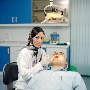 Sanaz, 32, has been a dentist for six years and treats both male and female patients. She was encouraged to train by her parents. 'There are many female dentists in Iran, she says. 'At the medical university women outnumber men. The foreign press always shows Iranian women as clichés, but things are different. Islamic law doesn't generally favor women but in Iran there are plenty of opportunities for women. Look at me.' Iran, Tehran, August 2006.