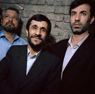 Ahmadinejad walking to the local mosque of his neighborhood to cast his vote in the second round of elections that will bring him unexpectedly to be the sixth president of Iran. He is surrounded by two of his bodyguards. Iran, Tehran, July 2005.