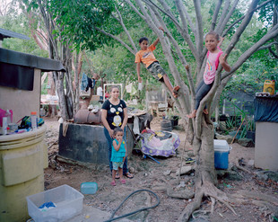 Kandra Powery, 25, and her three children, Kayla, 9, Kaleb, 8, and Janae, 2. The Caymans, a thriving offshore financial center, is the fourth-richest country in the Americas (GDP per capita) but has real pockets of poverty. 55% of the labor force is composed of non-nationals occupying both low-paying jobs in the service sector and high-end jobs in the finance industry. Grand Cayman