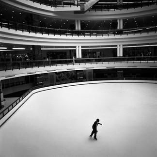 A man skates at the heart of a climatized shopping centre. Outside the temperature reaches 40 degrees centigrade. In countries on the Arab peninsula electricity is never a problem: oil is burnt to produce it.