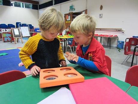 Boys exploring mirrors
