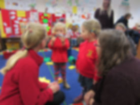 Children talking to staff at Teddy Bears