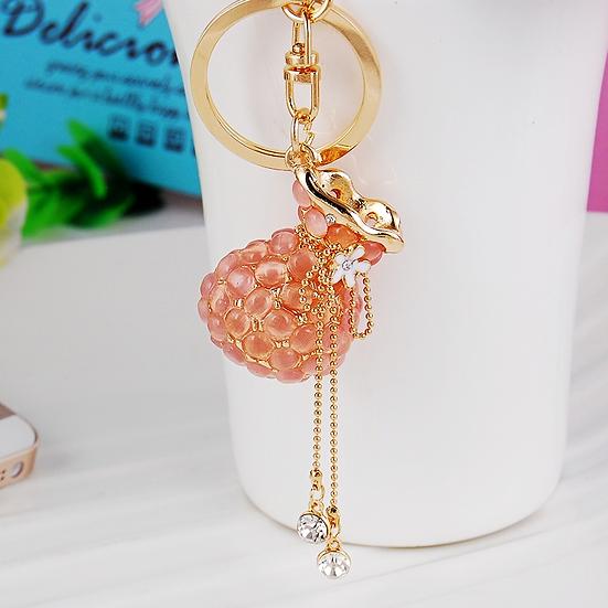 Llavero y accesorio para cartera: bolsa con colgante