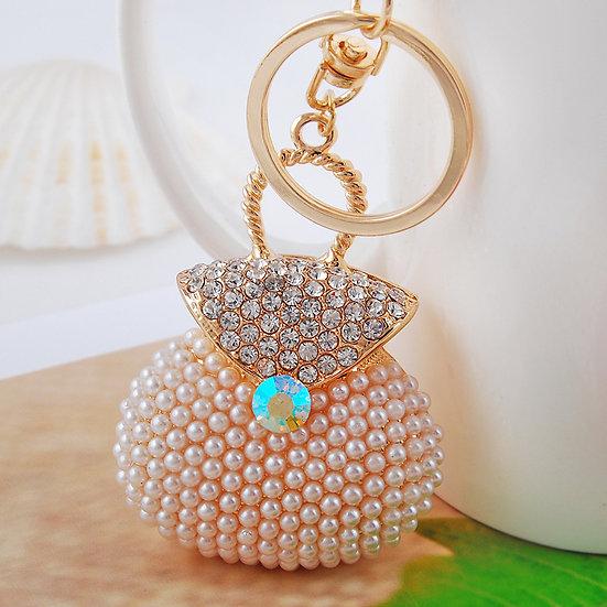 Llavero y accesorio para cartera: cartera con perlas