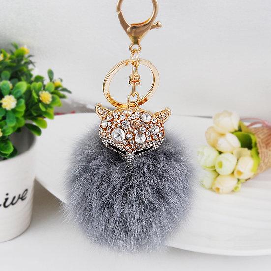 Llavero y accesorio de cartera: zorro con pompón