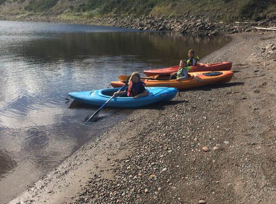 Kayaks on Cheticamp River Cape Breton Riverside Retreat