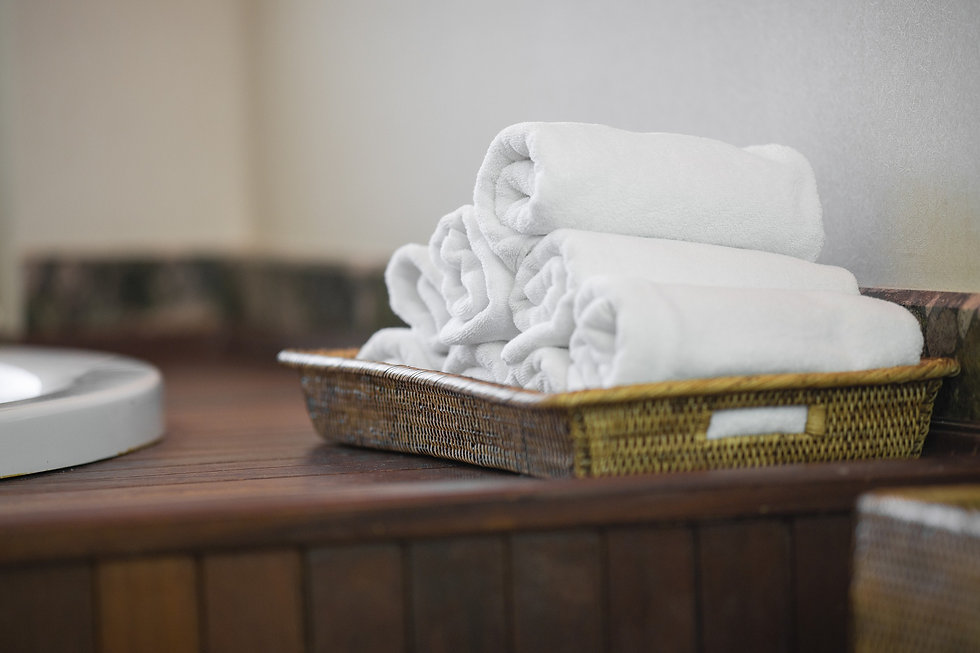 Pile of white towels in basket