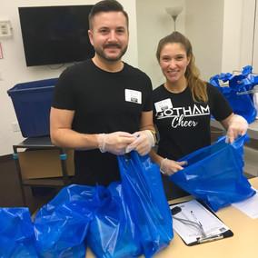 Gotham Cheer cheerleaders helpvolunteer and prepare weeked meals for Sage NYC