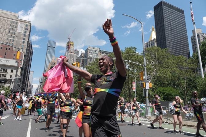 gotham cheer male cheerleader at world pride 2019 in rainbow uniform