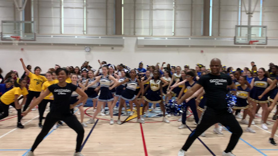 Gotham Cheer cheerleaders colunteer at manhattan youths annual cheer competition in NYC