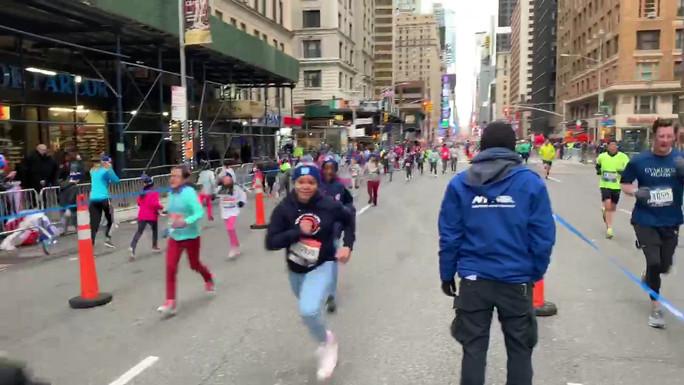 Gotham Cheer cheerleaders at NYRR Rising New York Road Runners NYC Half Race