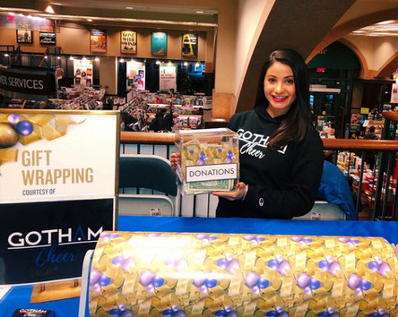 gotham cheer cheerleaders at Barnes and Noble in NYC volunteer Christmas and Hanukkah gift wrapping for charity