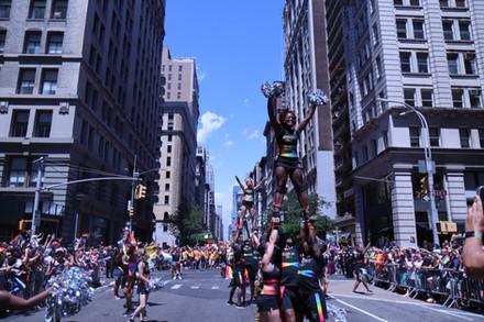 Gotham Cheer adult gay Cheerleaders perform on 5th avenue at World Pride NYC 2019