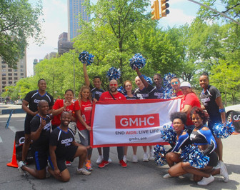Gotham Cheer NYC adult gay cheerleadering at  AIDS Walk New York with Team GMHC