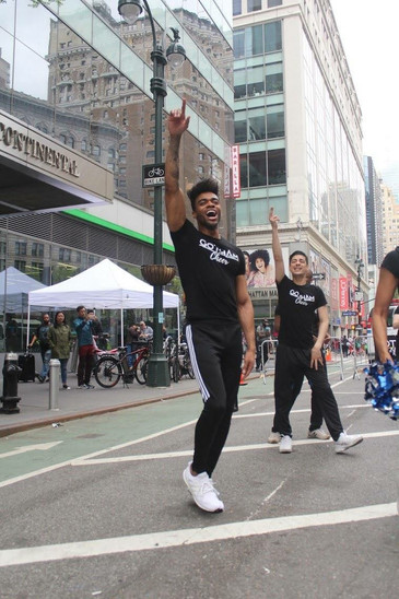 gotham cheer male cheerleader at Bike New York TD Five Boro Bike Tour