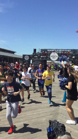 Gotham Cheer cheerleaders at Popular Brooklyn Half Marathon in Coney Island
