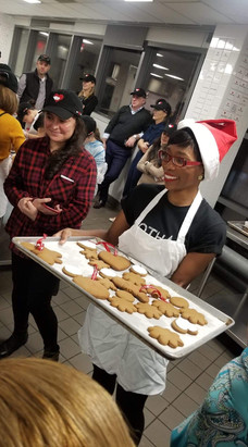 Gotham Cheerleasers volunteer at God's Love We Deliver Cookie Decorating Party in NYC