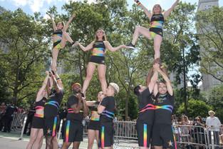 Gotham Cheer adult gay cheerleaders perfom r a pyramid at NYC World Pride 2019