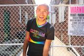 gotham cheer male cheerleader in rainbow uniform at Queens Pride Festival