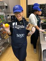 Gotham Cheer volunteer cheerleaders at Sage NYC offices Dinner service event
