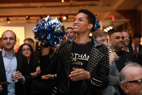 Gotham Cheer Cheerleader at Bailey House Gala event with Pom Poms