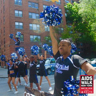 Gotham Cheer cheerleaders at  AIDS Walk New York cheering for walkers