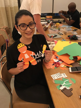 Gotham Cheerleaders Volunteer with True Colors United NYC offices creating materials for Impact Summit 2019