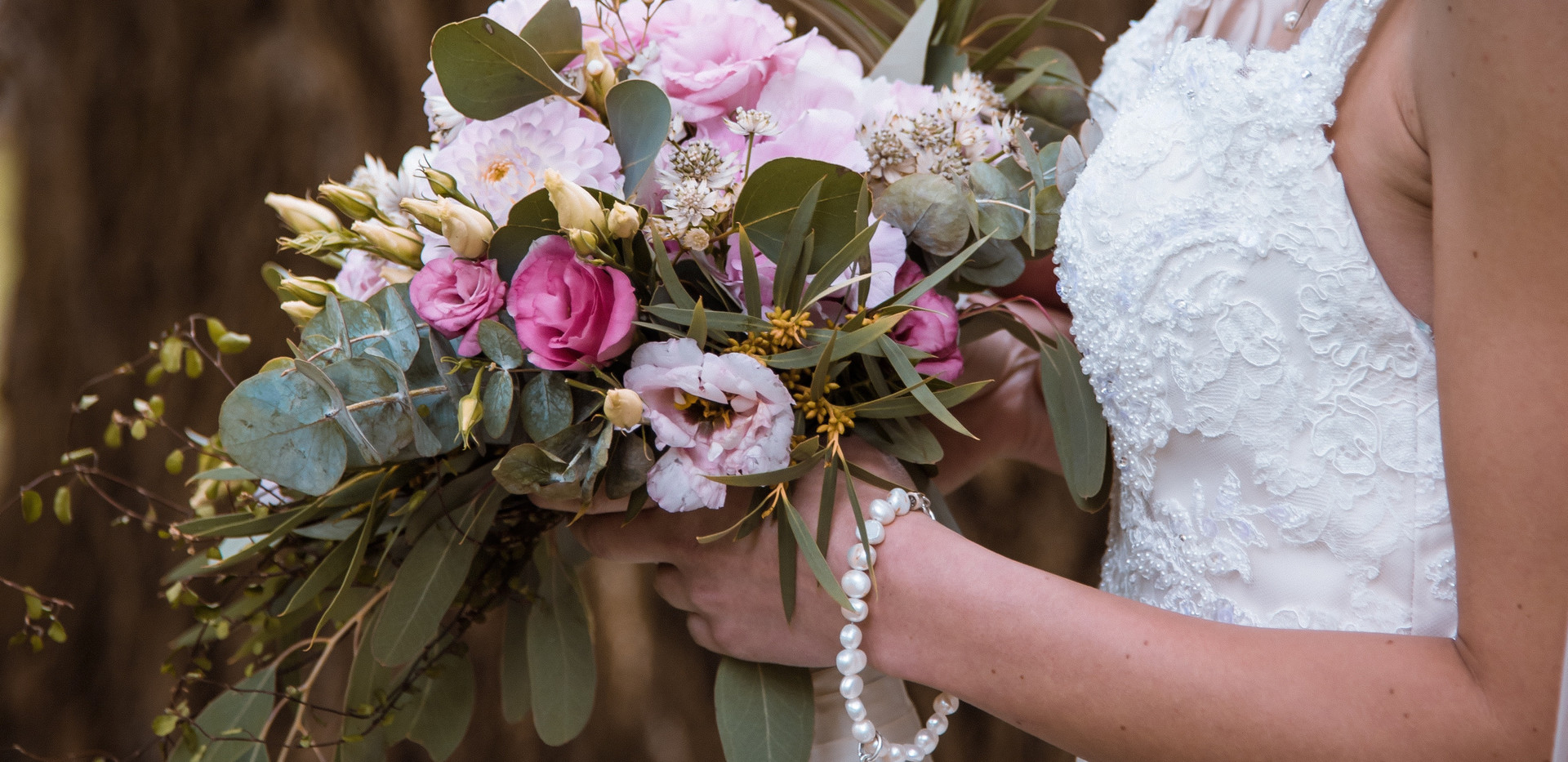 Canva - Bride Holding a Bouquet of Flowe