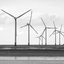Wind_Farm_In_Mud_Flat_Develop_Shoals_And_Renewable_Energy_Concept.jpg