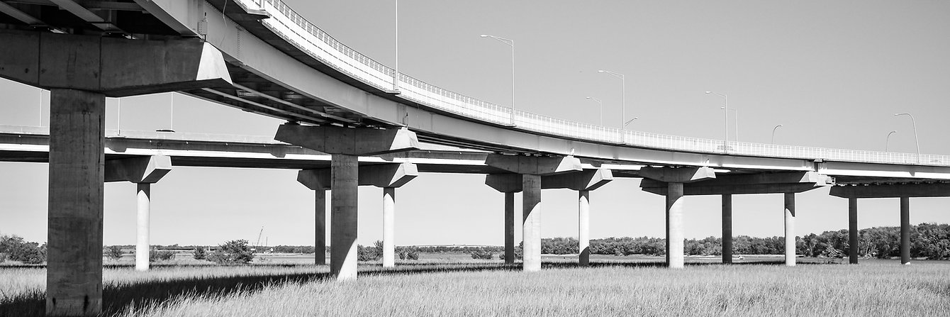Long_Raised_Concrete_Bridge_Crossing_Marsh.jpg