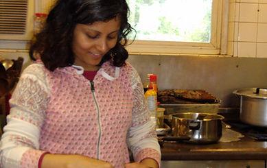 Anu Trzaska prepping food for workshop.