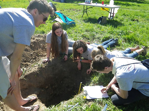 high school students examine soil pit for Envirothon