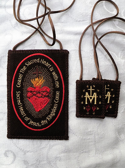 Sacred Heart Badge next to small 1.5 x 2 inch brown scapular