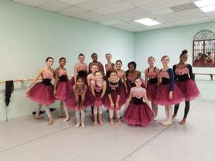 Company members trying on Flowers costumes for Nutcracker