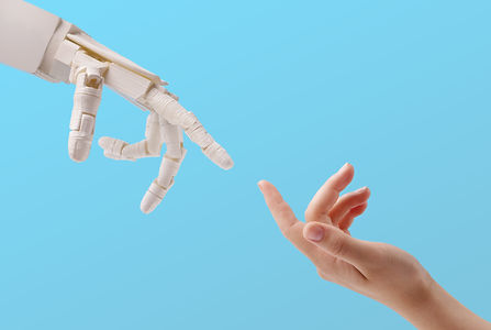 Connection between people and artificial intelligence technology. Female hand and robot re...lue.jpg