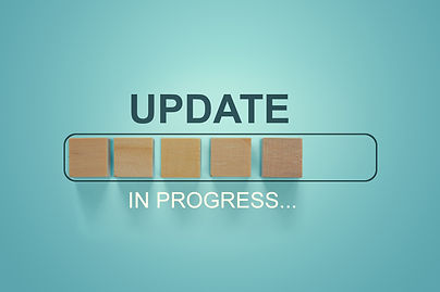 Wooden blocks with the word UPDATE  in l