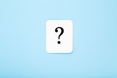 White card of question mark on light blu